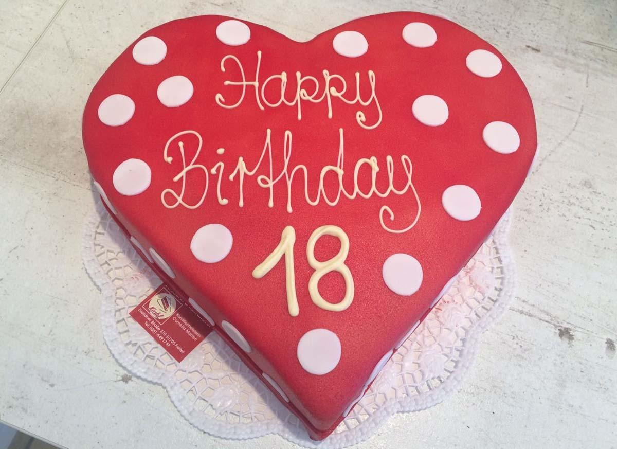rote Geburtstagstorte mit weißen Punkten