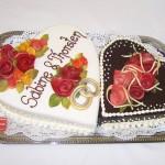 herzförmige Hochzeitstorte mit Marzipanverzierung